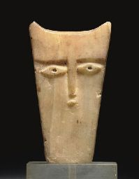 A SOUTH ARABIAN ALABASTER HORN-HEADED STELE PROBABLY CIRCA 1ST CENTURY B.C./A.D.