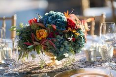 Colorful wedding centerpiece with blue hydrangea by Petalworks.