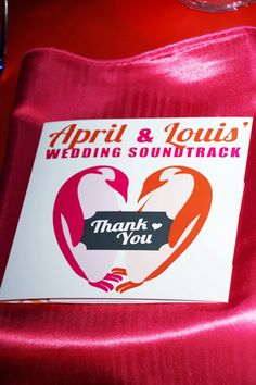 Wedding Favor for each guest - a Soundtrack of all the songs played at the wedding. For an Orange and Pink Penguin themed Wedding at the Florida Aquarium.    #Penguin #Wedding #Orange #Pink #Wedding Favor