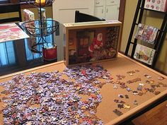 Make your puzzles portable.  Hide under the couch when you need your table space! The cork keeps the pieces from sliding around.