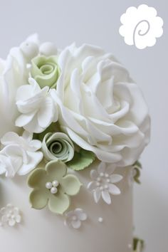White and soft green rose wedding cake