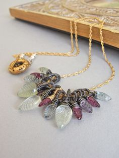 The Raspberry Leaf necklace - AAA gemstone leaves have been carefully wirewrapped, and then suspended from a fine goldfill chain.