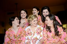 We adore these cute pink floral printed silk robes for the bridesmaids