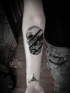 Levin's take on the traditional skull tattoo. #InkedMagazine #skull #tattoo #tattoos #Inked #blackandgrey