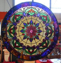 Stianed Glass Victorian Gem Panel. This Panel measures approx 31 inches in diameter. It was built in the foil and solder method. A Stained glass panel built by Cheri. It is named the Victorian Gem Panel. It was built using a wide range of color and textured glass. It has been