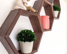Handcrafted Geometric Shelf Set Shelves are in a honeycomb pattern using hexagon shapes. Attractive modern set of shelves creates a fun design in any home! Creates whimsical and artistic design and function! Display all your favorite trinkets, knick knacks, books and collectibles. • Easy Installation Set can be configured multiple ways, including the pictured configuration. **SIZE & DESCRIPTION** Hexagon Interior: 11L x 10H x 3.5D Set of 3 Hexagon Shelves. Shelves are made from Pine Wood....