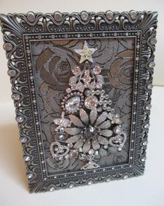 This beautiful little tabletop or wall Christmas tree measures 6 inches by inches from the outside edges of the pewter rhinestone frame. Vintage Jewellery Crafts, Old Jewelry Crafts, Costume Jewelry Crafts, Jewelry Ideas, Jeweled Christmas Trees, Wall Christmas Tree, Xmas, Jewelry Frames, Jewelry Tree