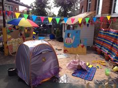Seaside role play area with beach hut, ice cream parlour and beach activities.