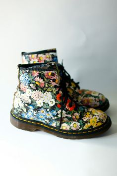 Flowered Dr. Martens. I own these and contantly get stopped by people passing by, most recently by The Idiosyncratic Fashionsitas at the Antique and Vintage   Textile show here in New York. See their blog (with a picture of my shoes and me) at idiosyncraticfashionistas.blogspot.com