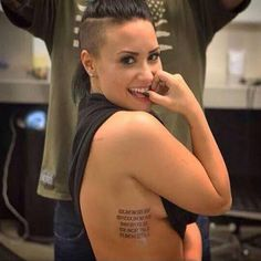 For inking number 15, Demi kept things close to home, debuting a ribcage tattoo that's etched with five lines of roman numerals. Savvy fans and Twitter uses quickly decoded the new design, and figured out that each line of text stands for a family member's birthdate.   - Cosmopolitan.co.uk