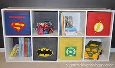 Superhero Storage Boxes - Did you know that even simple storage boxes – carton, plastic or cloth can become a part of this superhero theme? If you are using some carton boxes, you can either paint them or wrap them in felt paper of different colors before adding the logos of your son's favorite superheroes. If you will do this, this will encourage him to put back his toys from where they came because of the colorful superhero designs.