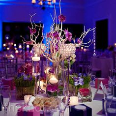 Tall crystal candlesticks and colorful flowers marked the head table at the reception.