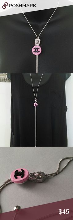 "Chanel Vintage Snap Button Necklace Unique and simply stunning long zipper style necklace  that adjust to place the Chanel button at any position you desire. Move the zipper up and down the silver tone snake chain to adjust and compliment any outfit. Will come with both snap buttons as seen in last photo. Zipper has the word ""Love"" on the side. Chanel snap is 18mm. Necklace is approximately 40"" long. Chanel Vintage Button Jewelry Necklaces"