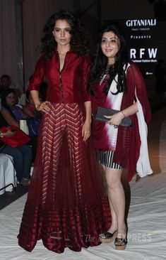 Kangana Ranaut was stunning in a maroon blouse with a flowing sheer skirt and pants to match at the India Resortwear fashion Week 2013. #Fashion #Style #Bollywood #Beauty