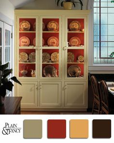 A decorative custard china cabinet with a cranberry red toned back with mustard yellow accents  #cabinets #red #yellow #china #paint #design #palette #hutch