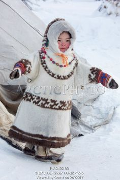 Image of 3 year old khanty girl, angelina ozelova playing outside at a khanty reindeer herder's winter camp. shuryshkarsky region, yamal, nw siberia, russia by ArcticPhoto