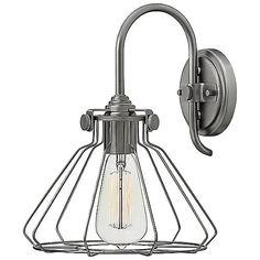 The edgy, industrial Congress 3113 Wall Sconce by Hinkley Lighting features an exposed bulb surrounded by a steel wire cage. The resulting light is strong, but distinct and spreads out in all directions. Like the fixture, the light itself has personality, eliciting a rugged ambiance that fits well in specific modern and industrial settings. A perfect opportunity to display vintage filament bulbs (available separately).