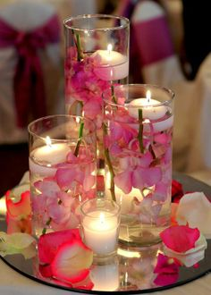 Stunning candlelit floral wedding centerpieces designed by Anelia