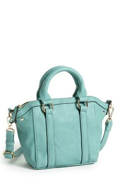 Gorgeous mint faux leather on the outside. Gorgeous chevron lining on the inside.
