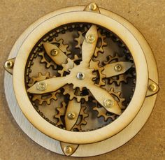 Wooden gear desk toy with gears that move by SteamyTech on Etsy, $30.00