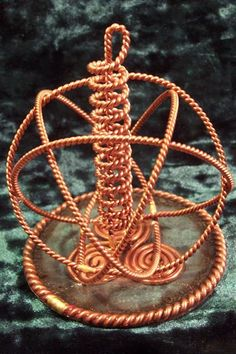 """The Activator. Orgone base ties the unit together as one solid piece. Consists of a Tensor Ring base for amplification, Heddeka for added beneficial frequencies. Iron Pyrite to facilitate the flow of Earth's Magnetics (when used as a portal activator), Half Sacred Cubit Tensor Field Generator for amplification and transmission, New Earth Coil for toridial field expansion and translation/communication. 3.5"""" x 4"""" in height. Sphere of Influence for this device is up to 5 miles wide."""