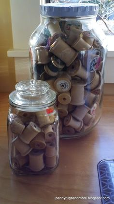 Sewing room ideas-- my best friend got me some of these with vintage threads and an old mason jar. What cute decor!
