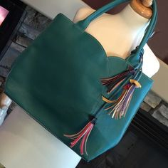 "Mellow World turquoise handbag Cute color with burst of color details, EUC, non smoking home, 15""x3 1/2""x12"" with a 9"" drop, 2 interior slip pockets and 2 interior zipped pockets, zip closure, faux leather Mellow World Bags"