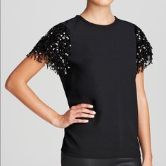 ‼️PRICE REDUCED‼️Kate Spade Top! NWT! Gorgeous black crepe top with sequin fringes over short sleeves. crew neckline. Gold back zip closure. Relaxed silhouette. Brand new with tags! kate spade Tops Blouses