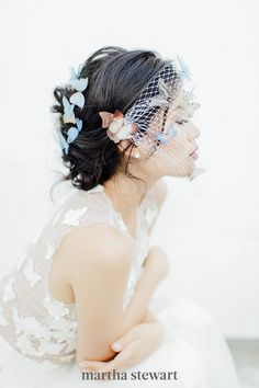 This classic veil option might be known as the bird cage, but this Butterfly Story veil is all about the butterflies. The colorful little creatures looked incredibly life-like; positioned on top of the veil and embedded into the bride's romantic updo, the critters appeared to be resting gently on the bride-to-be. #weddingideas #wedding #marthstewartwedding #weddingplanning #weddingchecklist Types Of Veils, New York Bride, Chapel Length Veil, Vintage Veils, Romantic Updo, Wedding Day Inspiration, Nontraditional Wedding, Blue Wedding Dresses, Bohemian Bride