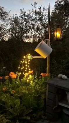 Today we have a beautiful outdoor DIY project to share with you. This glowing watering can with lights is so beautiful and SO easy to make! Pick a special spot in your garden or yard (maybe even your fairy garden) where you'd like to hang these glowing lights pouring from a watering can. It's gorgeous and unique! To make a glowing watering can with lights that look like they are pouring water, you will need the following supplies (the proper lights can be hard to find, but keep check