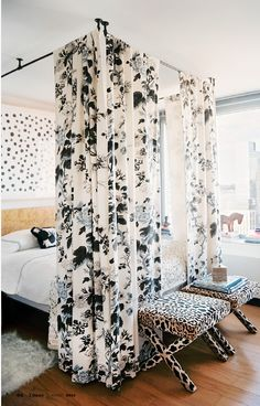 Curtains hung from the ceiling, create an inexpensive, glam canopy.