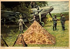Airmen hiding a camoflaged Luftwaffe Messerschmitt Bf 110 twin engined heavy fighter under netting and branches on an improvised airfield during the Second World War. Contemporary propaganda postcard. Pin by Paolo Marzioli