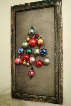 Vintage ornament display - what a great idea.  I must do this with the ones my Mom gave me!  http://www.flickr.com/photos/17504982@N07/6523681957/  #vintage #ornaments #christmas #display #tree #idea #framed #retro #old #antique
