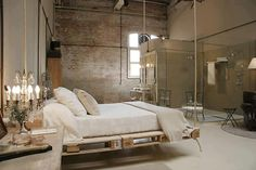 """I have a thing about open bathrooms - I like to attend to my personal needs behind a closed door and solid walls, so for me this bedroom has a big """"not for me"""" in it.    But, I love the swinging pallet bed!!!!!!!!!!!!!!!!!!"""