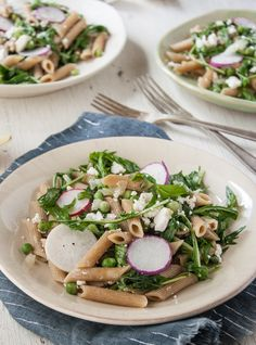 Peppery mizuna, sweet peas, and crunchy radishes punctuate this easy springtime pasta recipe. Can't find mizuna locally? Arugula will work too!