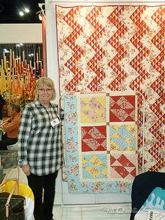 Simply Fat Quarters goes to Fall Market - Fat Quarter Shop's Jolly Jabber  I love the quilt on the wall with the half square triangle zig zag design!