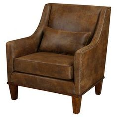 "Bring a touch of stately style to your living room or den with this handsome arm chair. Upholstered with nailhead-trimmed faux leather, this dapper design offers foam-cushioned comfort to your home.  Product: ChairConstruction Material: Faux leather, wood, plywood, fiber and foamColor: BrownFeatures:  Pillow includedNailhead trim Dimensions: 37"" H x 33"" W x 33"" D"