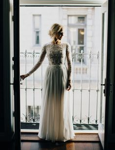 long sleeve dress with a beaded bodice and a flowing skirt is perfect for a relaxed wedding