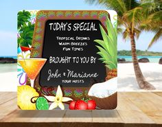 Personalized Today's Special Tiki Bar Sign With Chalkboard, Cocktail, Palm Trees, And Tropical Fruits - Fun Sign Factory. Bring a totally tropical vibe to your home or backyard décor with this personalized today's special chalkboard sign! Give guests a taste of the exotic with this custom tiki bar welcome sign, and pass around the piña coladas. Featuring a customizable chalkboard style background, palm trees, cocktail, coconut, pineapple and other tropical fruits, this fun home bar…