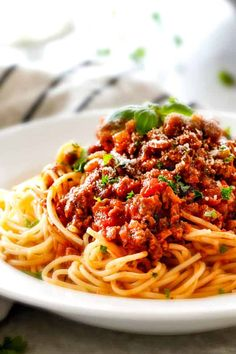 Spaghetti Bolognese that is rich and hearty, tastes like it's been simmering for hours but is on your table in less than 30 minutes! It deliversBIG, bold, complex flavors in super LITTLE time and is destined to become a family favorite!