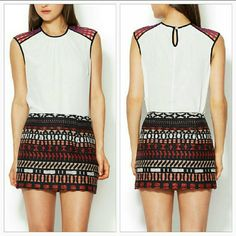 "🚨⚡SALE🚨Vena Cava Quintana fitted mini skirt NWT Brand new with tags   Vena Cava has done it again designing this fabulous embroidered mini skirt. This fashion forward skirt has an array of colors, navy blue, burnt orange, cream and tan. Pair with a sassy top and heels! Pleated skirt.  Length approx 13 1/2"" Waist approx 15"" seam to seam/approx 30"" all the way around Skirt material 61%Polyamide 39%Acrylic Fully lined 100%polyester Hidden zipper, hook closure on side Designer Vena Cava…"
