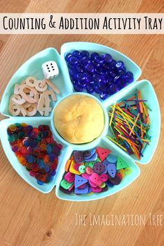 Counting and Addition Activity Tray Math Game Children roll die, and add that many objects to their ball of play dough.  Can make multiple sets and then add those together.