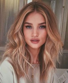 Stunning Rosie Huntington Whiteley with soft hair waves and cat flick eyeliner…