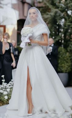 One shoulder ball gown wedding dress with high slit for the sophisticated bride | A-line Wedding Dress by Pollardi | How to Choose a Wedding Dress in 2021- Belle The Magazine | See more gorgeous bridal gowns by clicking on the photo