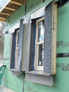 Insulated, splayed window surrounds anticipate the depth of the exterior wall insulation. The Pro Clima housewrap on the window surrounds will be taped to the wall housewrap after insulating.