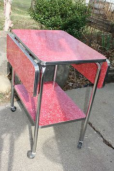 """Mid Century Modern Red Formica/Chrome Drop Leaf Serving Cart Table = Cart Envy My kitchen table is similar to this; same drop leaves, same Formica (called """"cracked ice""""), only blue, same metal rim around the top."""