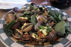 The Taiwanese Clams at Mission Chinese Food are made with hot basil, garlic, chinese bacon and black bean sauce.    Mission Chinese Food opened within Lung Shan Restaurant, at 2234 Mission Street, in 2011. Its origins trace to a sublet Guatemalan taco  I am unable to delay to nibble on !