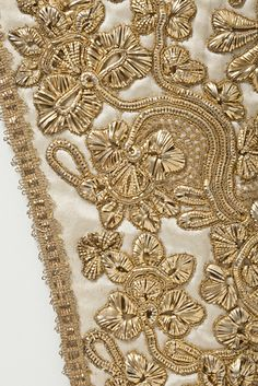 Close up of Goldwork on Stomacher.  Probably British.  ca. 1725 -1775.  Silk satin with metallic-thread embroidery and passementerie.