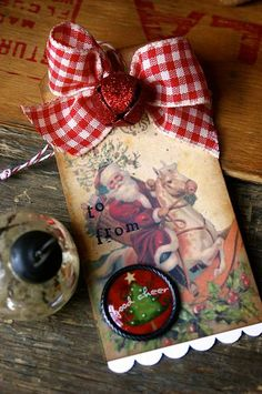 Vintage Christmas tags with red, glittered bells...
