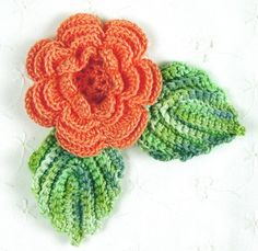 Lovely Crocheted Coral Irish Rose with Leaves Applique.